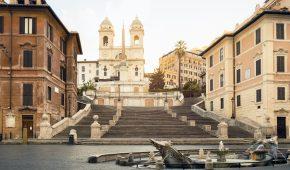 Piazza di Spagna with Fontana della Barcaccia and the Spanish Steps (Rome, Italy).